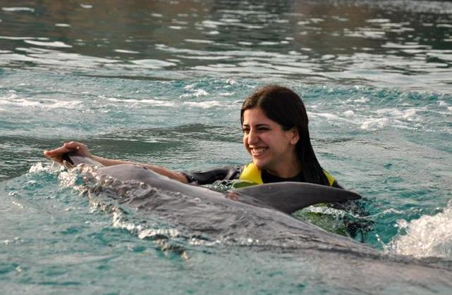 Aiisha with Dolphin